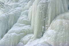 Frozen waterfall on mountain river Stock Image