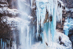 Frozen waterfall in the mountains. Royalty Free Stock Image
