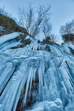 Frozen waterfall in the mountains Stock Images