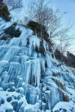 Frozen waterfall in the mountains. Landscape with a frozen waterfall in the mountains Stock Photography