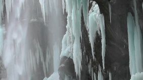Frozen waterfall in the mountains stock footage
