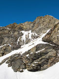 Frozen waterfall on mountainside. Frozen waterfall on the side of a mountain in Val Thorens resort in the French Alps Royalty Free Stock Image