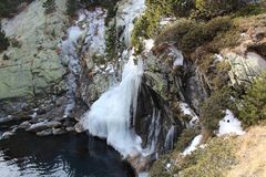 Frozen waterfall in Pyrenees mountains. Frozen waterfall in Pyrenees. Photo was taken at the river Nuria that leaves the damm of Vall de Nuria Royalty Free Stock Image