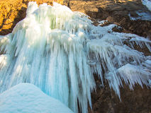 Frozen waterfall on a rock Royalty Free Stock Photos