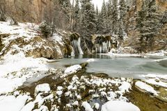 Frozen waterfall, snow, lake, mountains, colors, nature stock photography