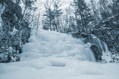 Frozen waterfall. Winter landscape, frozen waterfall on the mountain river. Shkotovsky waterfalls. Primorsky krai