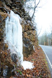 Frozen waterfalls on the side of a cliff. Stock Photo