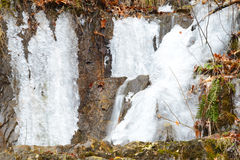 Frozen waterfalls on the side of a cliff. Royalty Free Stock Image