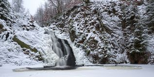 Frozen waterfalls in snowy forest. Frozen waterfalls in wintertime in the Ardennes in Belgium Stock Image
