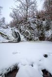 Frozen waterfalls in snowy forest. Frozen waterfalls in wintertime in the Ardennes in Belgium Stock Photography