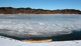 Frozen waters of the lake. In the cold winter, the lake is frozen Stock Photography