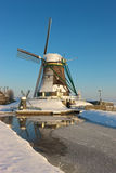 Frozen windmill. A frozen windmill on a sunny winter day in Dutch landscape Stock Photography