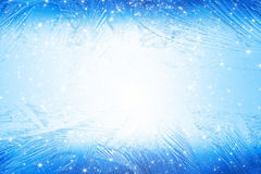 Frozen window. Abstract winter background - blue frozen window with bright light and stars Royalty Free Stock Images