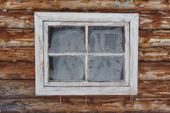 Frozen window in blockhouse wall. icicle. frost texture. New wood wall Royalty Free Stock Image