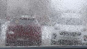 Frozen window of car in winter pan stock video footage