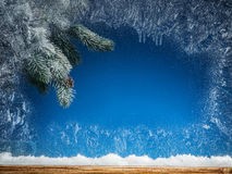 Frozen window and Christmas tree. stock photography
