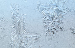 Frozen window glass. Frozen glass of a window in a cold winter day Stock Photography