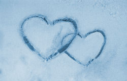 Frozen window and hearts stock images