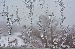 Frozen window  after the winter thaw. Stock Photo