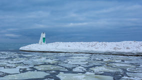 Frozen Winter Lighthouse. South Haven North Pier Light in a sea of ice Stock Photography