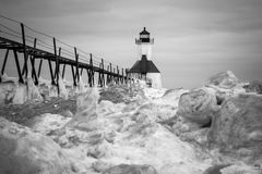 Frozen Winter Lighthouse. St. Joseph North Pier Lighthouse in January Stock Image