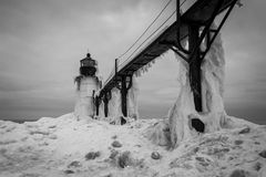 Frozen Winter Lighthouse. St. Joseph North Pier Lighthouse in January Royalty Free Stock Photography