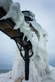 Frozen Winter Lighthouse. St. Joseph North Pier Lighthouse in January Royalty Free Stock Image