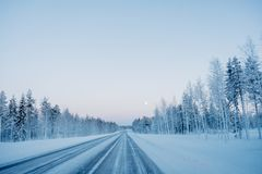 Frozen winter road in Finland royalty free stock images