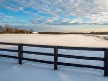 Frozen Winter Snow Rail Fence horse farm. Frozen Winter Snow Cedar Rail Fence Country farm field in winter snow frozen landscape horse farm Stock Photo