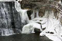 Frozen Winter Waterfall. Snow and ice cover a frozen winter waterfall stock photo
