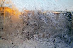 Frozen winter window.frosty pattern on the glass. royalty free stock image