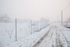 Frozen wire fence on a very cold and foggy winter day Stock Photo