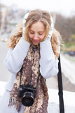 Frozen woman photographer in winter clothes Royalty Free Stock Image