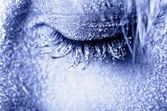 Frozen woman's eye covered in frost