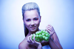 Frozen woman take grapes Royalty Free Stock Images