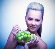 Frozen woman take grapes Royalty Free Stock Photos