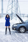 Frozen woman waits for roadside assistance Royalty Free Stock Image