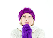 Frozen woman wearing cap and gloves Royalty Free Stock Photo