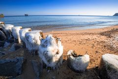 Frozen wooden breakwaters line at Baltic Sea. Babie Doly, Poland Stock Photos