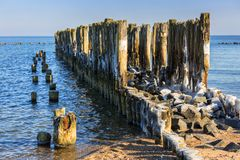 Frozen wooden breakwaters line at Baltic Sea. Babie Doly, Poland Royalty Free Stock Photos