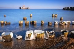 Frozen wooden breakwaters line at Baltic Sea. In Poland Stock Images