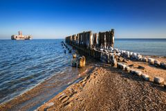 Frozen wooden breakwaters line at Baltic Sea. In Poland Stock Photography