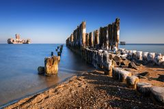 Frozen wooden breakwaters line at Baltic Sea. In Poland Stock Photo