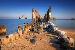 Frozen wooden breakwaters line at Baltic Sea. In Poland Stock Image