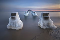 Frozen wooden breakwaters line , winter Stock Photo