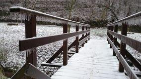 Frozen wooden bridge Royalty Free Stock Images