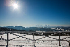 Frozen wooden fence in mountains winter landscape Stock Photography
