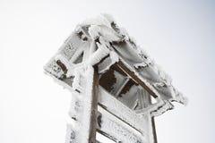 Frozen Wooden Signpost Stock Image
