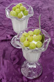 Frozen yogurt with gooseberries in a glass Stock Images