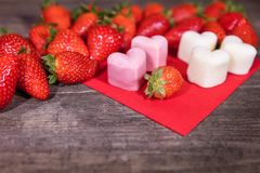 Frozen yogurt in a heart shape, Strawberries and froyo bites. On wooden table Royalty Free Stock Photo